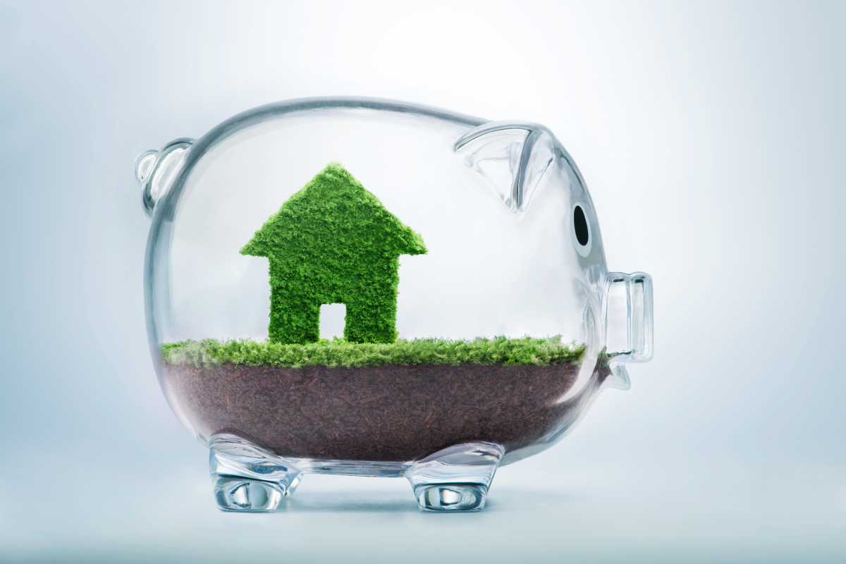 Développement durable à Nantes - Concept de l'économie et de l'écologie réunies dans un cochon avec de l'herbe