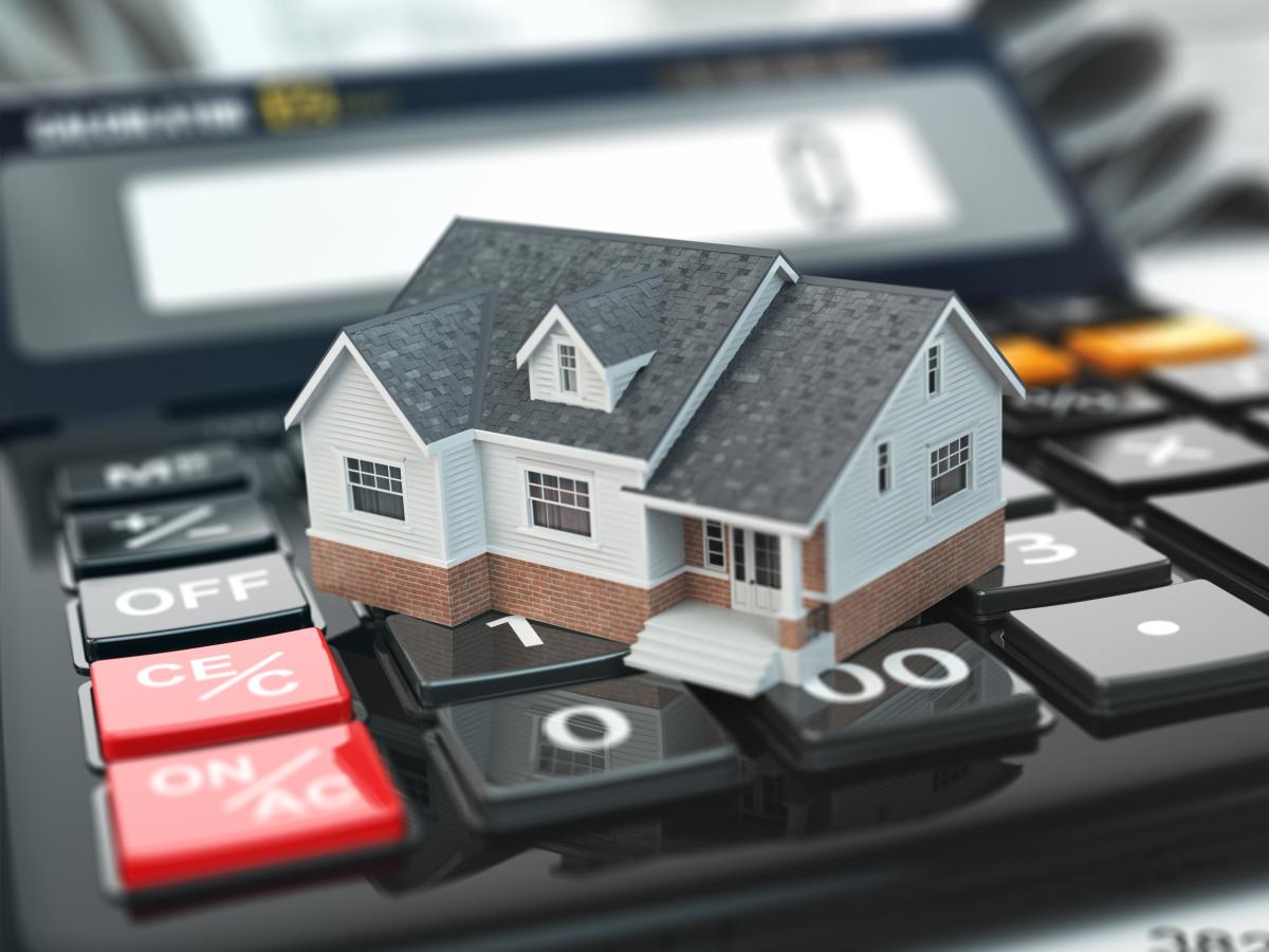 crédit immobilier à Nantes - Une maison sur une calculatrice