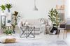 Défiscaliser à Nantes - Salon d'un appartement neuf avec canapé trois places blanc